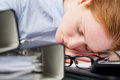Lazy worker sleeping on her desk a young businesswoman closeup image Royalty Free Stock Photo