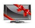 Lcd tv with a shiny red bow Stock Photos