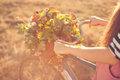 Ld bike handlebar with flowers basket girls arms holding an old Royalty Free Stock Image