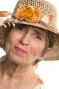 �ldrig h�g kvinna f�r sk�nhet med sommarhatten Arkivfoton