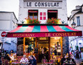 Le Consulat Restaurant, Montmartre, exterior with diners seated at cafe tables Royalty Free Stock Photo