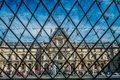 Le louvre the famous glass pyramid at the museum in paris Stock Photos