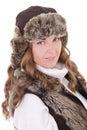 Le portrait de la jeune belle femme dans le chapeau et le gilet de fourrure a isolé o Photos stock