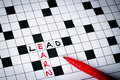 Lead earn on puzzle words Royalty Free Stock Photo