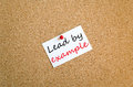 Lead by example sticky note concept Royalty Free Stock Photo