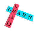 Lead and learn isolated words on color paper Stock Image