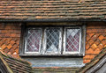 Leaded window and traditional sussex hung tiles Stock Photos