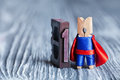 Leader superhero concept. Clothespin super hero and 1 one written with colored vintage letterpress. soft focus, copy Royalty Free Stock Photo