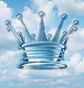 Leadership aspirations business concept and metaphor with a royal king crown floating in the sky as a success symbol of religion Royalty Free Stock Photography