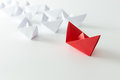 Leadership concept using red paper ship among white Stock Image