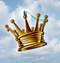 Leadership guidance business concept as a businessman directing a golden flying king crown with a harness as a success metaphor Royalty Free Stock Image