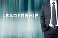 LEADERSHIP sign on motion blur abstract background with businessman Royalty Free Stock Photo