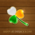 Leaf clover in Irish flag colors on wooden background Royalty Free Stock Photo