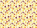 Variety of autumn leaves on yellow background