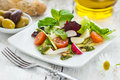 Leafy salad and mozzarella with pesto and tomatoes Stock Image