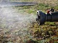 Leaking fire hydrant fine mist in rural setting Stock Image