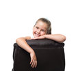 Lean on back of the armchair black office and smiling Royalty Free Stock Photo