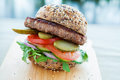 Lean beef burger with rocket pickles tomato and onions Royalty Free Stock Photography