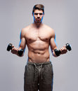 Lean and mean portrait of a very fit young man working out Royalty Free Stock Image