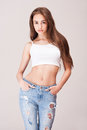 Lean and slender jeans beauty portrait of a beautiful young woman in Royalty Free Stock Photos