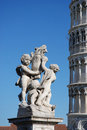 Leaning Pisa Tower and statue Stock Images