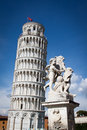 The leaning tower of pisa with cherubs in the foreground is visited by countless number tourists each year picture is isolated Royalty Free Stock Photo