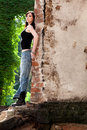 A leap into the unknown brunette profile having confident attitude leaning to brick wall Stock Photo