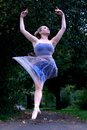Leaping Ballerina in Park Royalty Free Stock Image