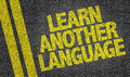 Learn another language written on the road Royalty Free Stock Image