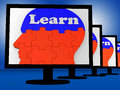 Learn on brain on monitors showing human studying or learning Royalty Free Stock Image