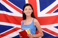 Learn English. Beautiful student holding books looking up. Royalty Free Stock Photography