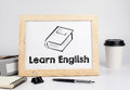 Learn English. Office table with wooden frame, space for text Royalty Free Stock Photo