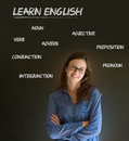 Learn english teacher with chalk background confident beautiful woman arms folded and glasses blackboard Stock Photo