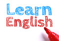 Learn english text with red marker aside is isolated on white paper background Royalty Free Stock Images