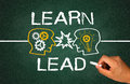 Learn and lead concept on chalkboard Royalty Free Stock Images