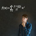 Learn math or maths teacher with chalk background confident handsome man thinking hand on chin and glasses blackboard Royalty Free Stock Image
