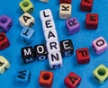 Learn more education puzzle words concept Royalty Free Stock Photos