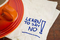 Learn to say no advice handwriting on a napkin with cup of coffee Stock Image