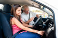 Learner driver girl intstructor taking lessons Stock Image