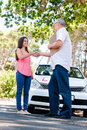 Learner driver girl intstructor taking lessons Stock Images