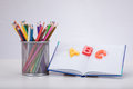 Learning concept with letters, book and pencils