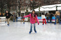 Learning how to skate girl learns on a rink in the hague holland picture taken on december in the hague holland Stock Photography