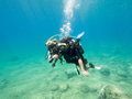 Learning to dive loutra greece august female scuba diver taking part in a training with her instructor more women are taking up Royalty Free Stock Photos