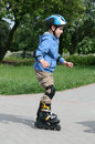 Learning to ride on rollerblades Stock Photo