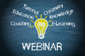 Learning webinar words on blackboard with lightbulb and the coaching education tutorial creativity knowledge and elearning Royalty Free Stock Image