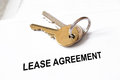 Lease agreement document with house keys Royalty Free Stock Photography