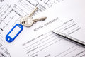 Lease agreement rental document with keys and pencil Royalty Free Stock Photo