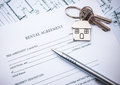 Lease agreement rental document with keys and pencil Stock Image