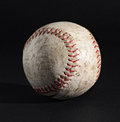 Leather baseball on black with stitching detail Royalty Free Stock Photo
