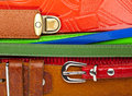 Leather belts background with metal buckles Stock Photos